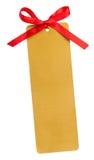 Étiquette d'or et arc rouge Photos stock