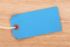 Étiquette de bagage de papier bleu Photographie stock libre de droits