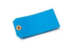 Étiquette bleue de bagage de carton ou de papier sur le blanc Photographie stock libre de droits
