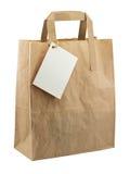 Étiquette de blanc de sac de papier d'isolement Photographie stock