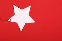 Étiquette de cadeau de forme d'étoile Photos stock