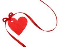 Étiquette de coeur avec le ruban rouge Photographie stock libre de droits