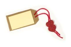 Étiquette de papier avec la corde et les coeurs rouges Image stock