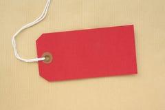 Étiquette de papier rouge de bagage Image stock