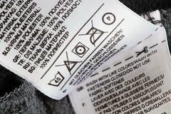 Étiquette de soin de blanchisserie image stock
