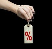 Étiquette de vente sur la main de femmes avec le signe de pour cent Photographie stock