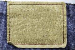 Étiquette en cuir blanc de jeans Photographie stock libre de droits