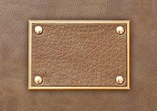 Étiquette en cuir dans un cadre en métal Images stock