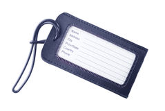 Étiquette en cuir de bagage d'isolement sur le blanc Photographie stock