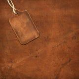 Étiquette en cuir sur le suède Photos libres de droits