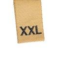 Étiquette légère de vêtement de taille de l'instruction-macro XXL sur le blanc Photos libres de droits