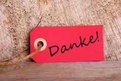 Étiquette rouge avec Danke Image stock