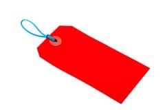 Étiquette rouge de bagage Images stock