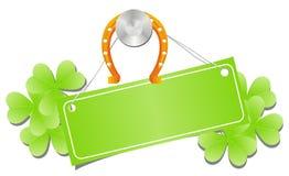 Étiquette verte avec le fer à cheval et l'oxalide petite oseille illustration stock