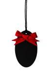 Étiquette vide noire avec l'arc rouge de ruban Photo stock