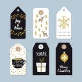 Étiquettes de cadeau de Noël de vintage réglées Les labels tirés par la main avec le houx d'or de Noël tressent, les cerfs commun Image stock