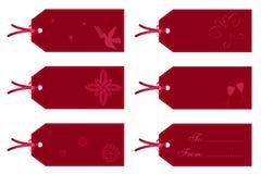 Étiquettes de cadeau en rouge Photographie stock libre de droits