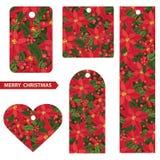 Étiquettes de Noël avec le fond rouge de poinsettia Photographie stock libre de droits
