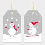 Étiquettes de nouvelle année avec des bonhommes de neige Image libre de droits