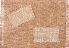 Étiquettes de toile à sac sur le matériau de toile à sac Image libre de droits