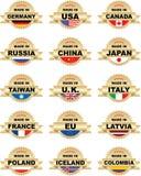 Étiquettes EFFECTUÉES DEDANS avec différents pays Images libres de droits