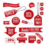 Étiquettes, insignes et rubans rouges de remise de vente Image libre de droits