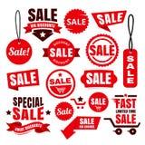 Étiquettes, insignes et rubans rouges de vente au rabais Photographie stock libre de droits