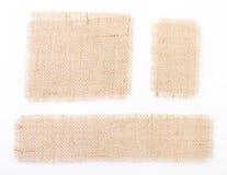 Étiquettes réglées de toile à sac au-dessus de blanc. toile de jute. Photo stock