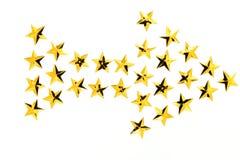 Étoile d'or de flèche photographie stock