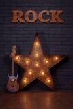 Étoile de guitare électrique et de fer Photographie stock libre de droits