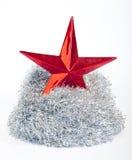 Étoile de Noël et tresse d'argent sur le blanc Photos stock