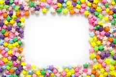 Étoile de papier pliée colorée ou étoile chanceuse d'origami à employer comme cadre Photographie stock