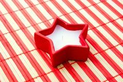 étoile de rouge de bougie Photographie stock libre de droits