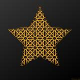Étoile fleurie en métal à l'arrière-plan noir, art marocain Photos stock