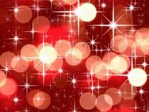 Étoile lumineuse et bokeh rouge de son Image libre de droits