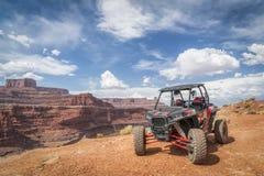 Étoile polaire RZR ATV sur la traînée du coin 4WD de poulet près de Moab Images stock