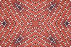 étoile Quatre-aiguë de brique rouge photographie stock