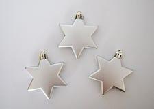 3 étoiles argentées Photographie stock