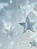 Étoiles argentées brillantes avec le rayonnement photos stock