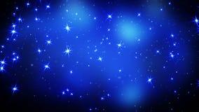 Étoiles brillantes sur le fond bleu Photographie stock