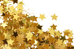 étoiles d'or de confettis Photo stock