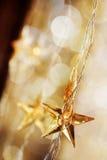 Étoiles d'or de Noël Photographie stock libre de droits