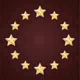 Étoiles d'or sur le fond texturisé rouge Photographie stock libre de droits
