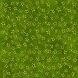 Étoiles d'or sur le fond vert Photographie stock