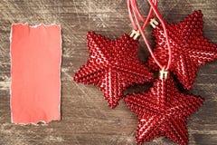 Étoiles de Noël avec le morceau de papier vide Photos libres de droits