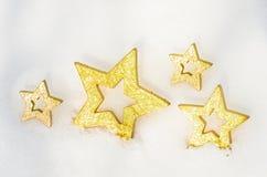 Étoiles de Noël dans la neige 5 Photographie stock libre de droits