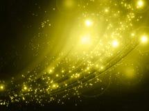 Étoiles descendant sur le fond d'or Images libres de droits