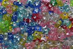 Étoiles en plastique de couleur Image libre de droits