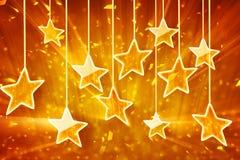 Étoiles et lumières s'arrêtantes oranges de bokeh Photos libres de droits
