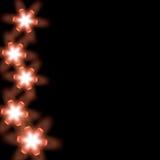 Étoiles légères dans le noir Photos libres de droits